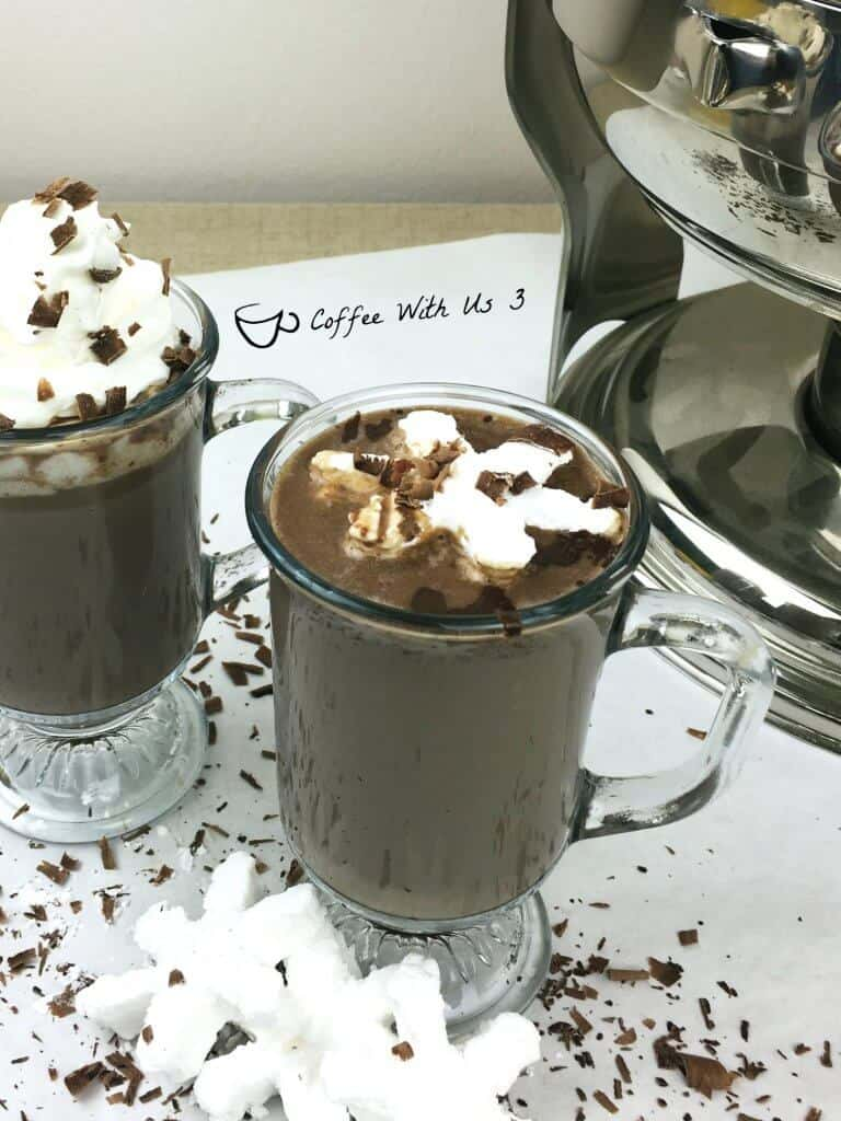 Dark Chocolate Hot Cocoa in mugs with snowflake marshmallows.