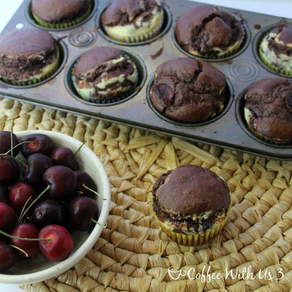 Chocolate Cherry Cheesecake Muffins: Chocolate muffins with chunks of fresh cherries throughout, stuffed with a creamy cheesecake layer. This homemade muffin recipe is perfect for busy breakfasts and snacks!