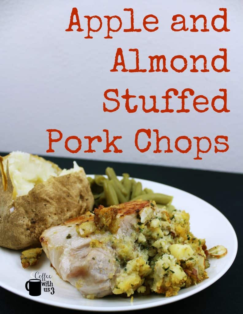 Apple and Almond Stuffed Pork chop on a plate with a baked potato and green beans.
