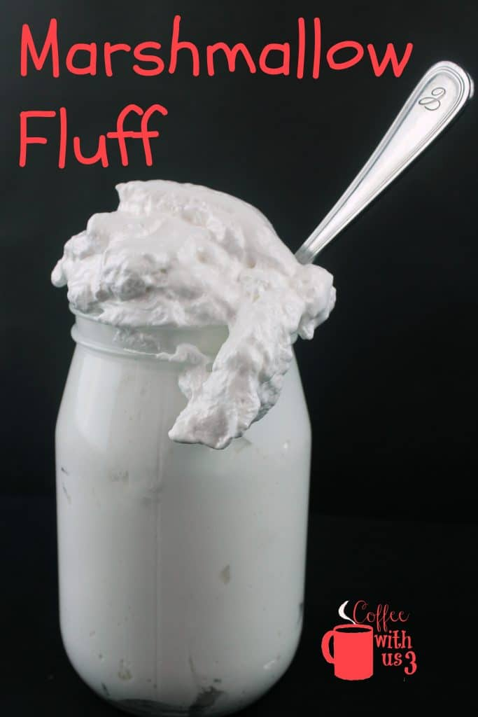 Homemade Marshmallow Fluff in a jar with a spoon