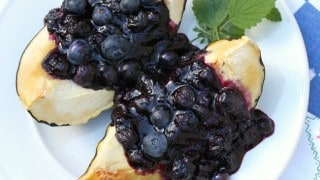 Baked Acorn Squash with Blueberry Sauce