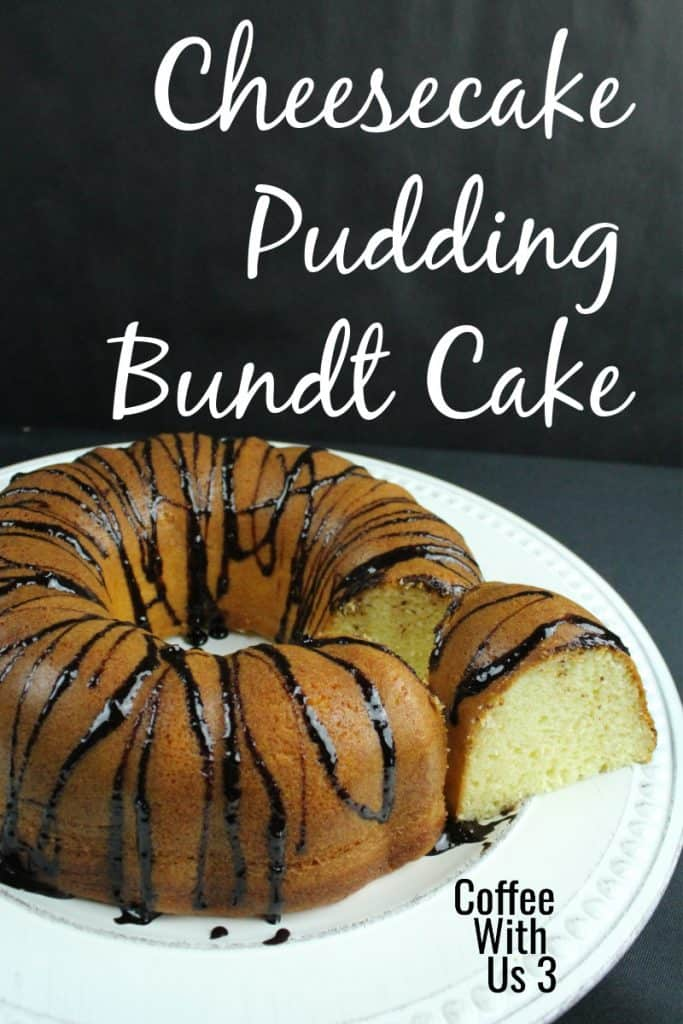 Cheesecake pudding bundt cake sliced on a white plate.