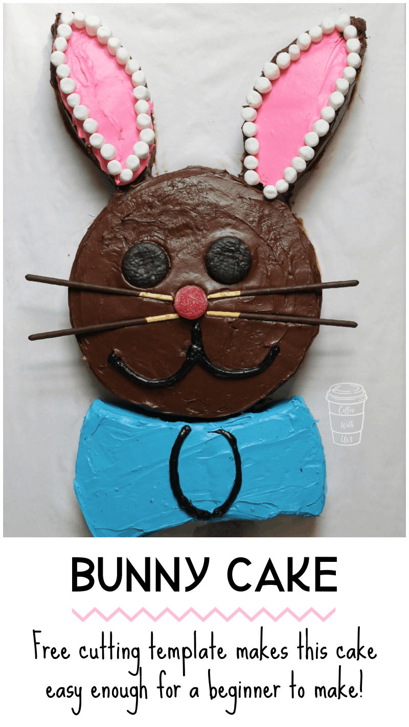 A cute chocolate Easter Bunny Cake with a blue bow tie and pink ears.